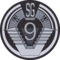 SG-9 badge.png